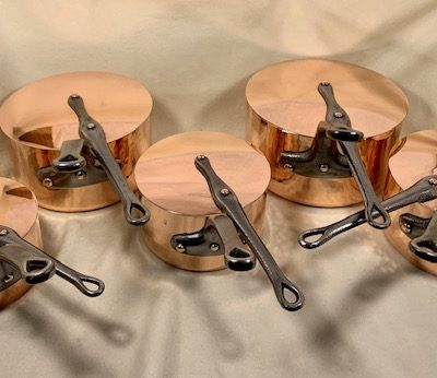 set of 5 copper saucepans